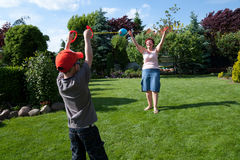 Family sport - playing wire-ball Royalty Free Stock Images