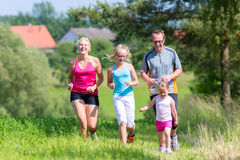 Family sport running through field Royalty Free Stock Photography