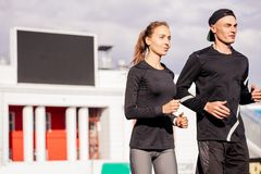 Family sport. young couple improving health. Close up side view shot stock photo