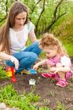 Family in spring garden royalty free stock photos