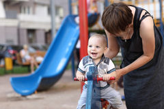 Family and spring toy horse. At outdoor playground Royalty Free Stock Photography