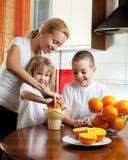 Family squeezed orange juice Royalty Free Stock Image