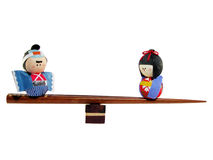 Family stability. Concept using Japanese papers dolls and chopsticks Royalty Free Stock Photography