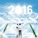 Family on the stairway looking at numbers 2016 Stock Photo