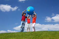 Family stand on grass and lift globe Royalty Free Stock Photo