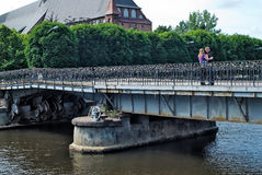 Family stand on Medovy Bridge. Kaliningrad.Russia Royalty Free Stock Photography