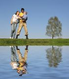 Family stand with son. Spring.water Stock Photography