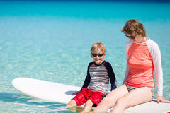 Family stand up paddling Stock Images
