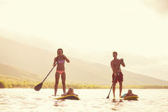 Family Stand Up Paddling Royalty Free Stock Image