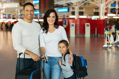 Family standing airport Stock Image