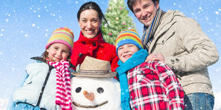 Family Standing Around Snowman And A Christmas Tree Concept Stock Photos