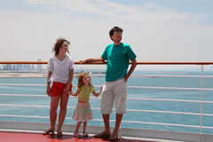 Family standing on cruise liner deck Royalty Free Stock Images