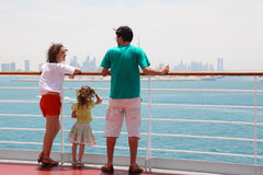 Family standing on cruise liner deck stock photo