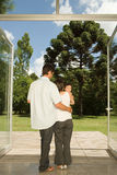 Family standing at doors to garden Royalty Free Stock Photos