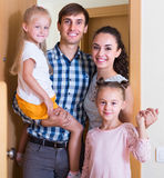 Family standing at doorway. Caucasian parents with kids standing at doorway of rented property royalty free stock photos