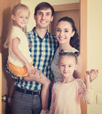 Family standing at doorway. Caucasian parents with kids standing at doorway of rented property stock images