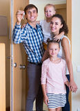 Family standing at doorway Royalty Free Stock Photo