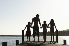 Family Standing On Edge Of Jetty Royalty Free Stock Photo