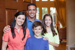 Family standing in entryway of home Royalty Free Stock Images