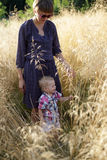 Family standing in field of grass Royalty Free Stock Image