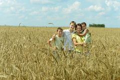 Family standing in field Royalty Free Stock Photography