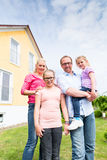 Family standing in front of home or house Stock Photos