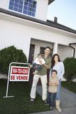 Family Standing In Front Of House For Sale Royalty Free Stock Image