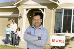 Family Standing In Front Of New House stock image