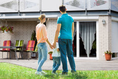 Family Standing In Front Of Their House Stock Photos