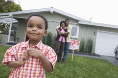Family Standing In Front Of Their New House Stock Photography