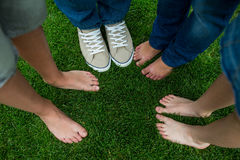 Family standing on grass in park. On a sunny day Royalty Free Stock Images