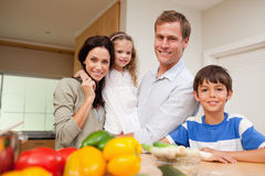 Family standing in the kitchen Stock Images