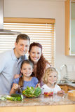 Family standing in the kitchen Stock Photography