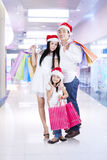 Family standing in mall while holding shopping bags Royalty Free Stock Images