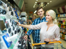 Family standing near beauty stand. Family 25s standing near beauty stand in shop Stock Image