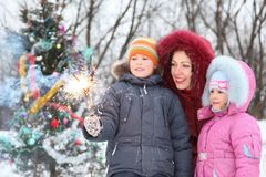 Family is standing near christmass tree Stock Image