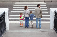 Family standing near crosswalk, behind Royalty Free Stock Photos