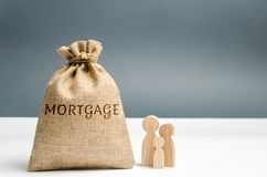 Family standing near the money bag with the word Mortgage. Loss of property for failure to pay mortgage rates. Loan for housing. Real Estate Alienation. Big stock image