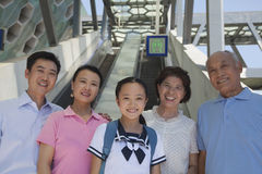 Family standing next to the escalator near the subway station Stock Photo