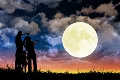 Free Family Standing On Hill And Watching The Moon.Celebrate Mid-autumn Festival Royalty Free Stock Photography - 156354207