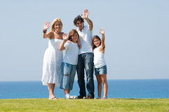 Family standing outdoors waving royalty free stock images