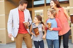 Family Standing Outside Cinema Together Stock Photo