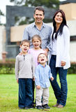 Family standing outside house Stock Photography