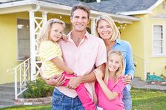 Family Standing Outside Suburban Home royalty free stock image