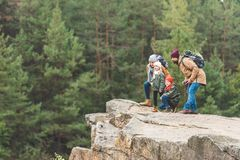 Family standing on rock in forest Royalty Free Stock Photo
