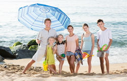 Family standing on sandy beach Royalty Free Stock Images