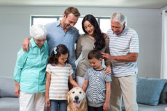 Family standing together with dog royalty free stock image
