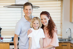 Family standing together in the kitchen Stock Image