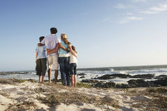Family Standing Together On Seashore Stock Photos