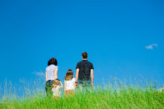 Family Standing At The Top Of A Hill Stock Image